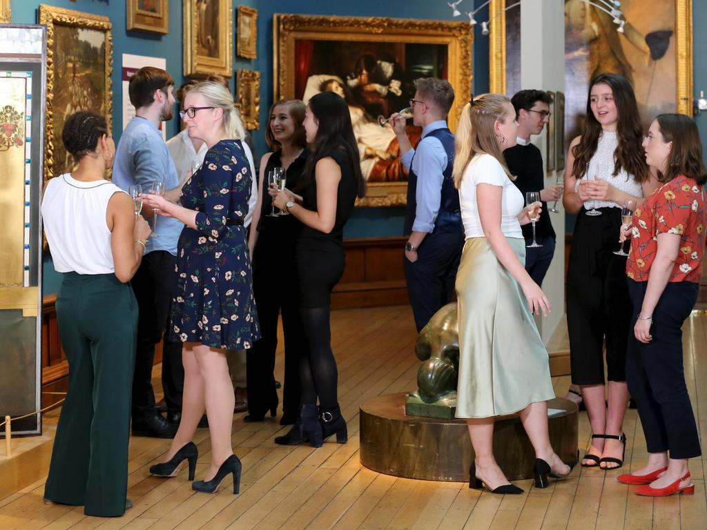 Image: Guests enjoy drinks in the Upper Gallery