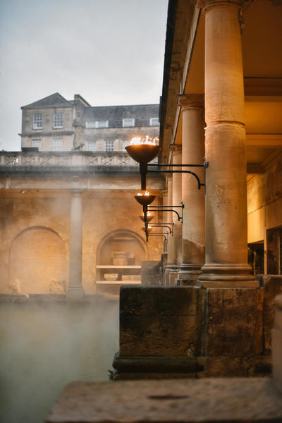 Image: The Great Bath with torches lit