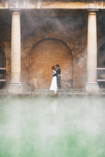 Image: Wedding couple beside the steaming waters of the Great Bath