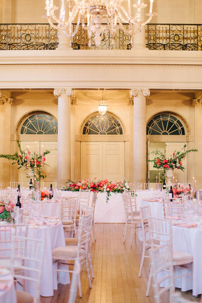 Image: Long top table in front of pillars