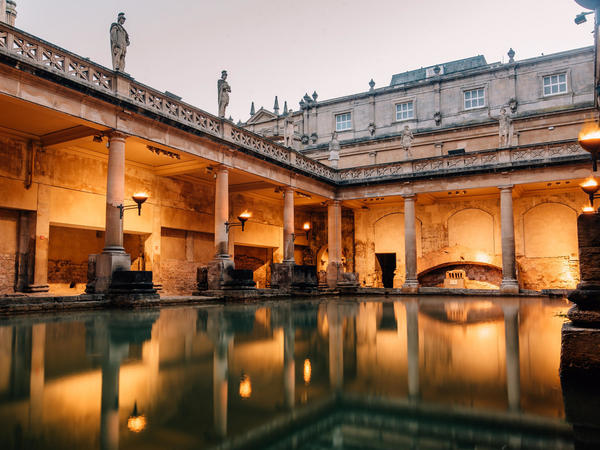 Image: The Torch lit Roman Baths